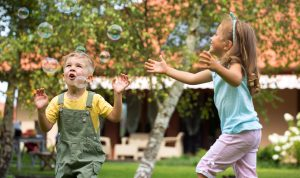 kids happily playing with bubbles